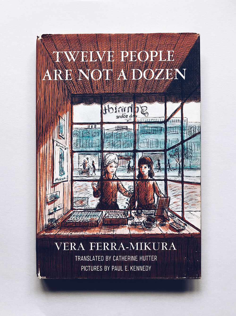 "Cover and illustrations for ""Twelve People Are not a Dozen"" by Vera Ferra-Mikura, translated by Catherine Hutter; Vintage children's book on Dover Books"